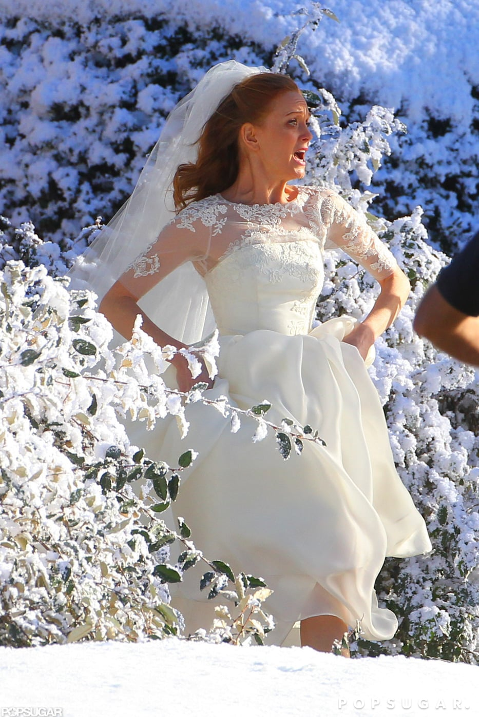Jayma Mays filmed a scene for Glee while wearing a wedding dress.