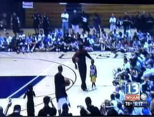 Child Plays Basketball With Michael Jordan