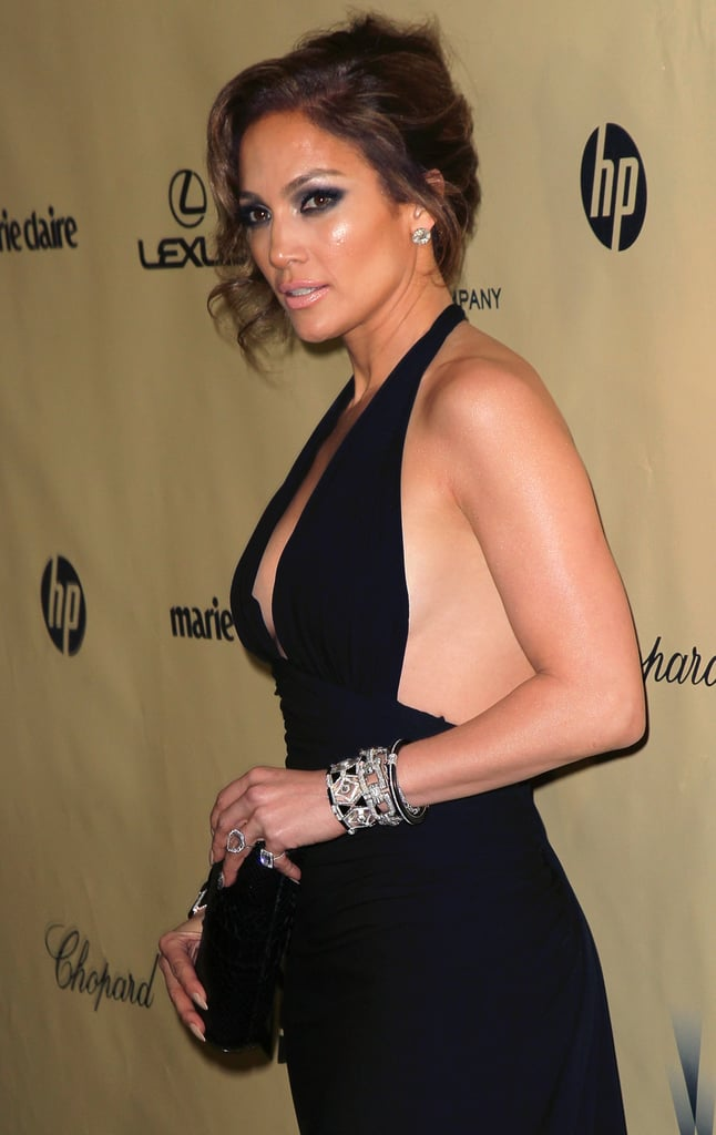 Jennifer Lopez changed out of her sparkly, nude Zuhair Murad gown into a low cut black look for the Golden Globe afterparties.