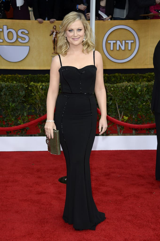 Amy Poehler looked svelte in a black form-fitting Zuhair Murad gown, green crocodile clutch, and diamond earrings.
