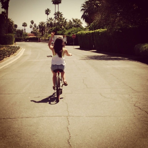 The actress, who plays Aria Montgomery on Pretty Little Liars, stays active by biking in the LA sun.