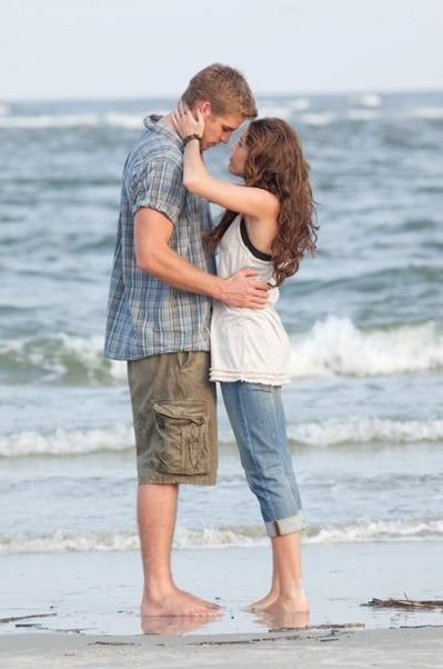 Liam Hemsworth and Miley Cyrus embraced while filming The Last Song. Photo courtesy in Disney.
