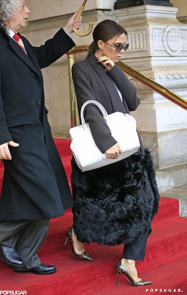 Victoria Beckham walked down the stairs.