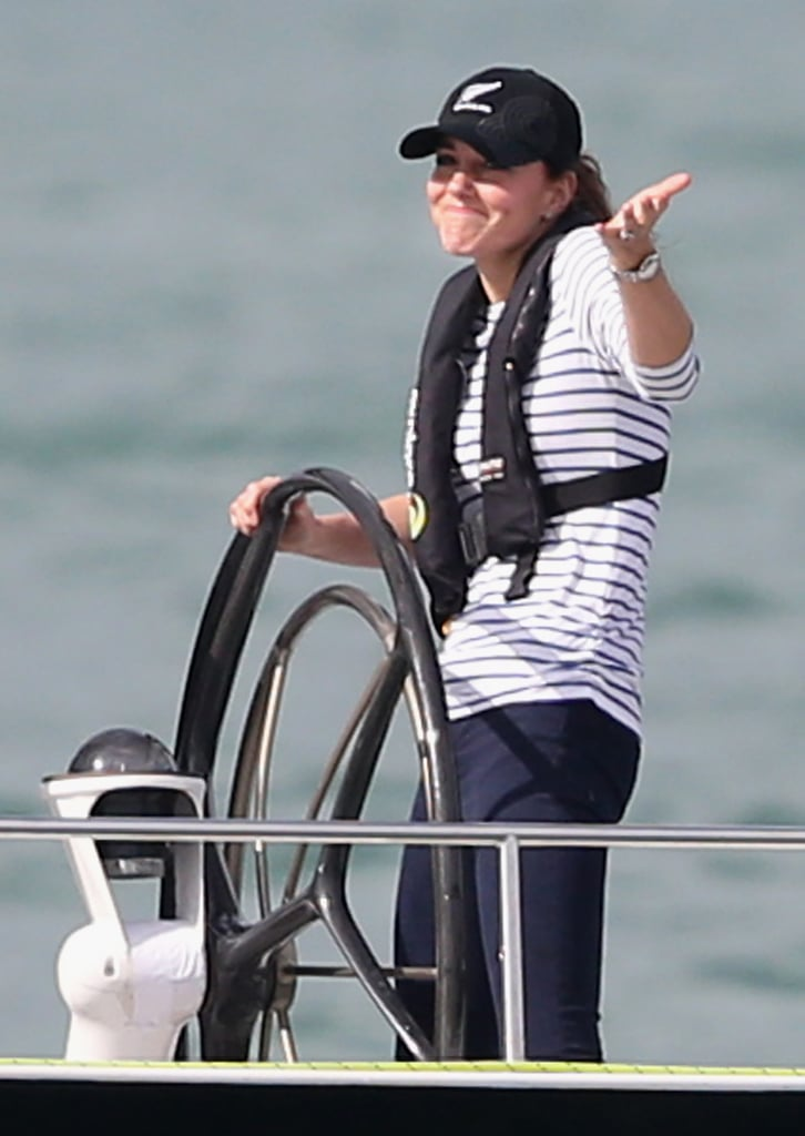 """The face says it all! Kate shrugged and smiled as she passed William's boat during a friendly race in Auckland, New Zealand, on April 11. William later said he was """"sabotaged."""""""