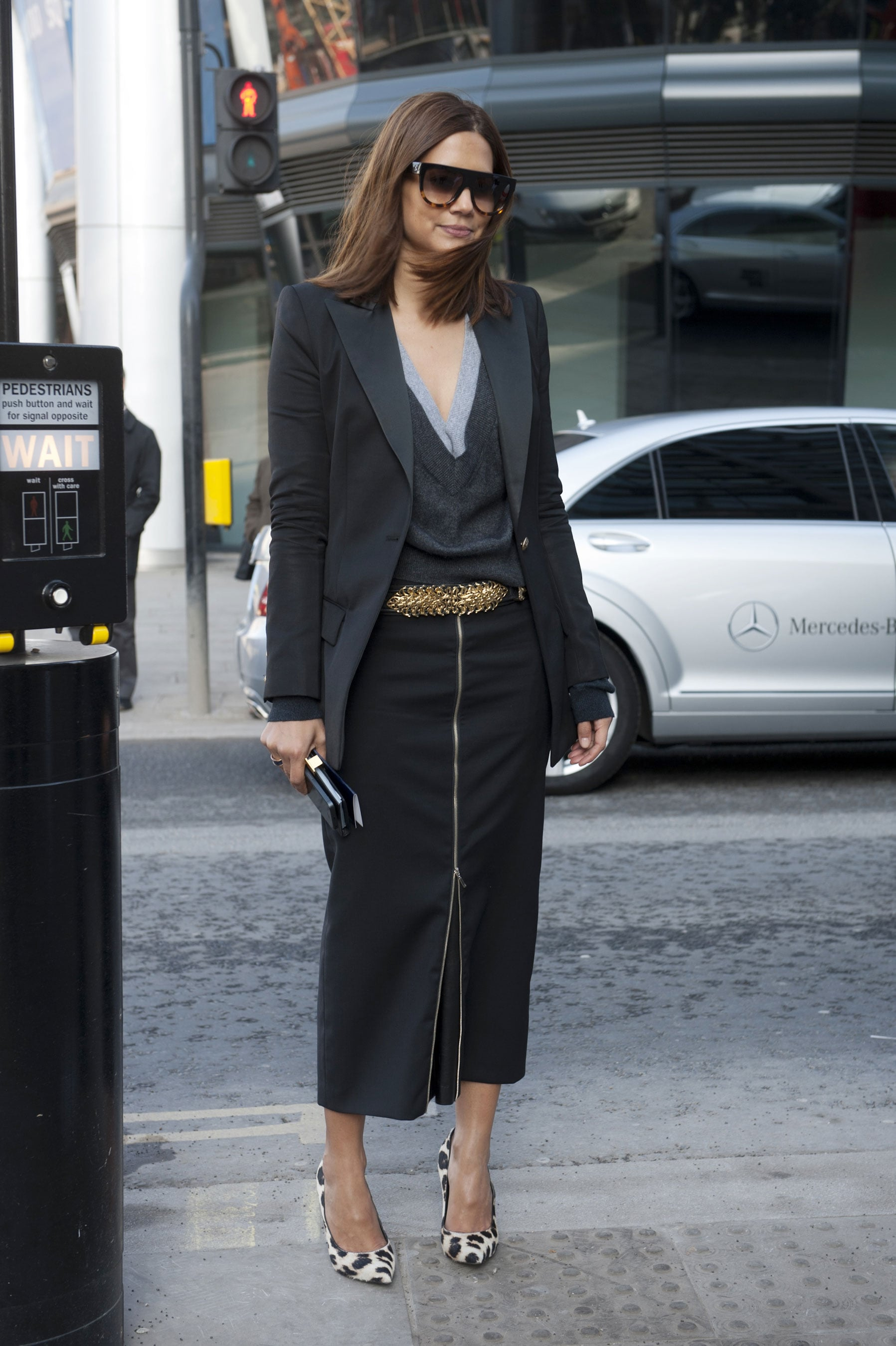 Layer up a slouchy sweater with a sharp blazer and a sleek pencil for a totally corporate-cum-cool vibe — note how slick it looked on Christine Centenera.