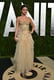 Selena Gomez chose a nude, corseted, and ruffle-skirted Atelier Versace gown for the 2013 Vanity Fair Oscars afterparty.