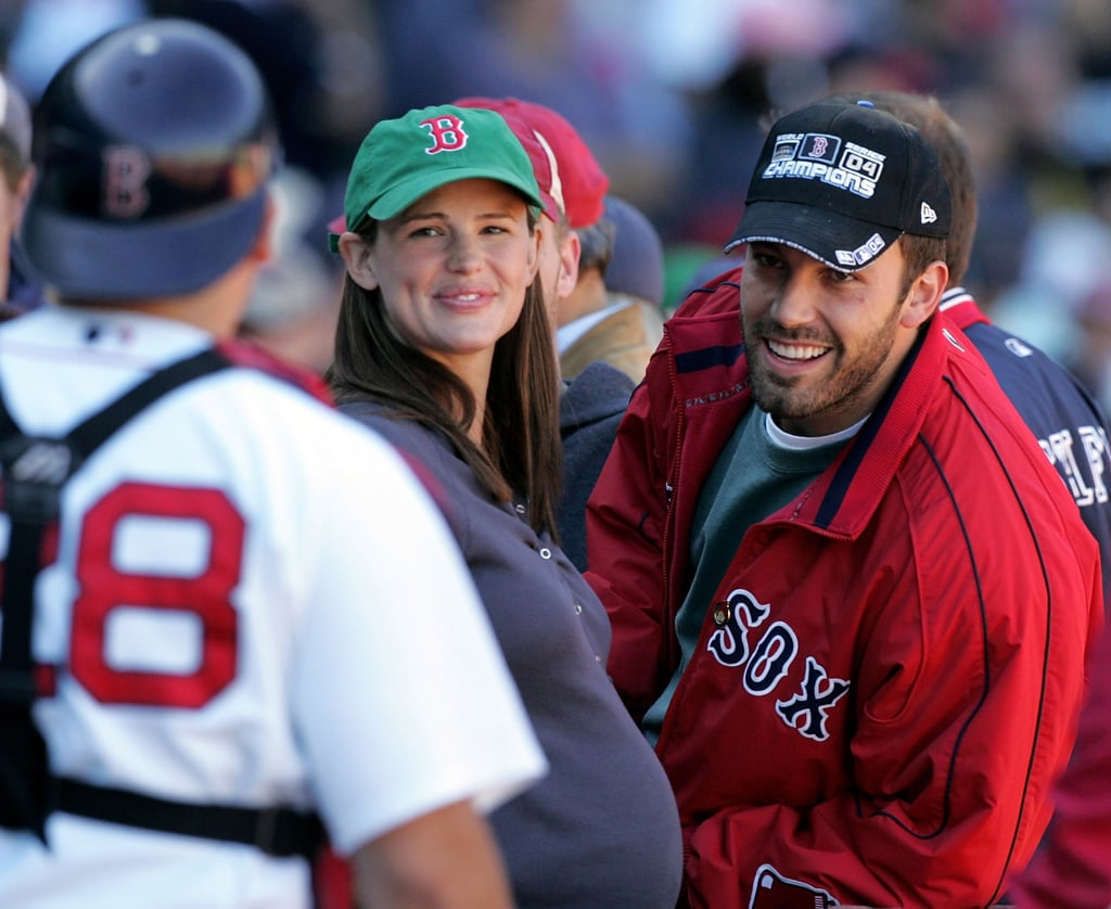 The couple chatted with a Boston Red Sox player during an October 2005 game in Boston.