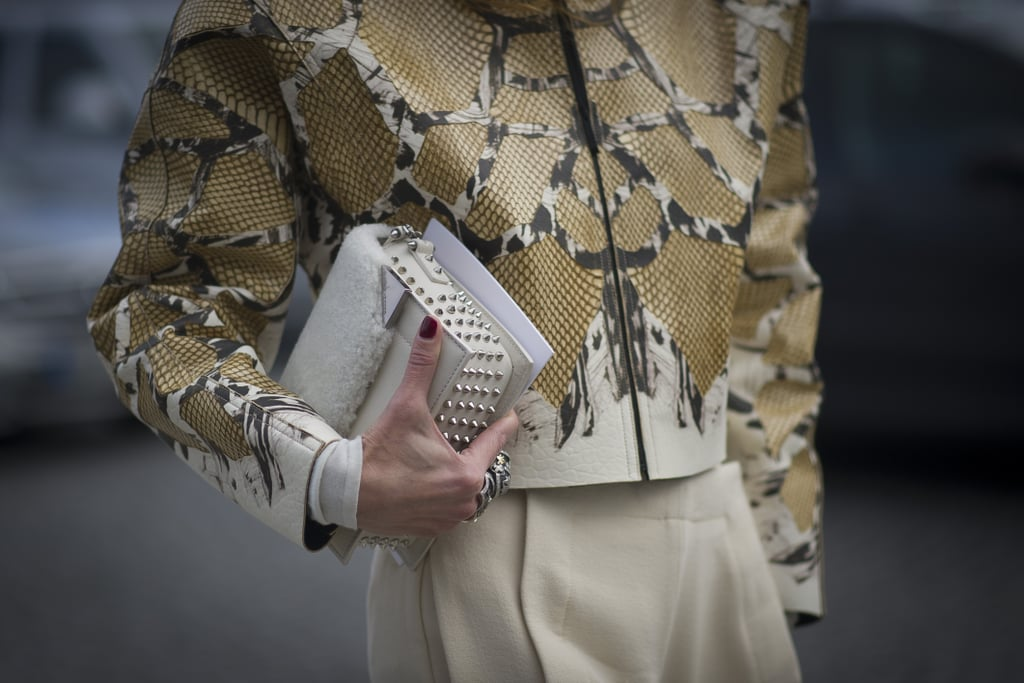 She piled on the texture with a furry finish on her bag and an exotic finish on that jacket.