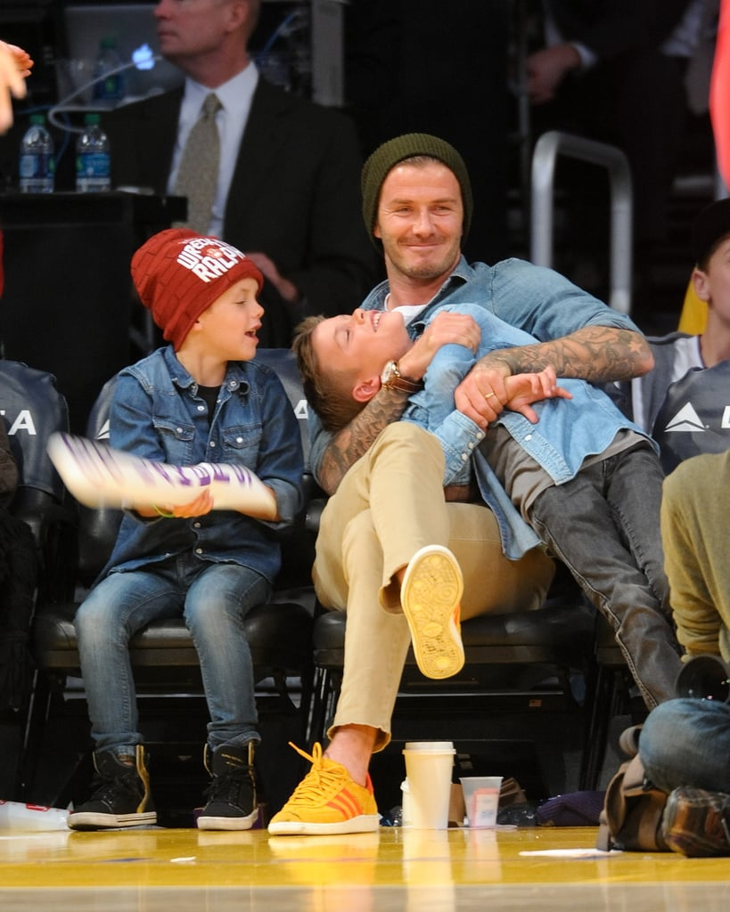 David Beckham clowned around courtside with his sons Cruz and Romeo during a Lakers game in November 2012.