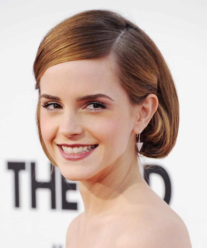 Sliding a bobby pin behind the ears of the shorter side of a deep side parting kept Emma Watson's faux bob looking sleek. This is a great look to try if you have naturally straight hair that doesn't hold a curl very well.