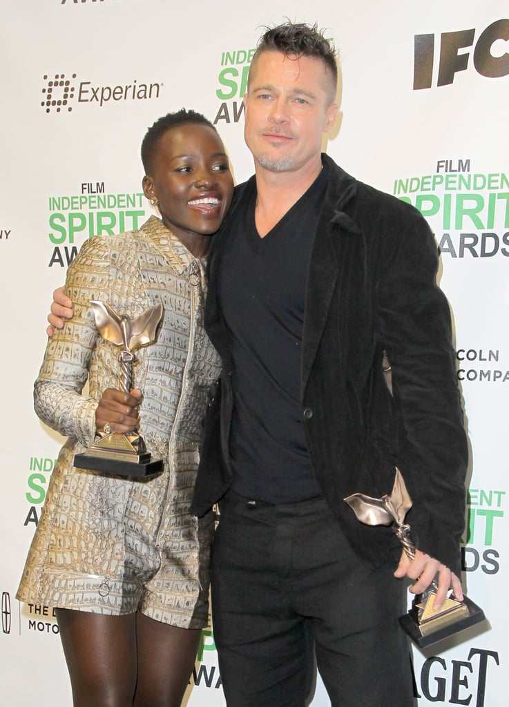 Brad Pitt gave Lupita a hug as they posed with their Independent Spirit Award statues in the press room.