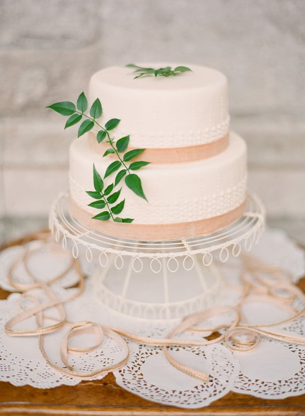Just a hint of bead-like texture, lace, and leaves make this one divine dessert.  Photo by KT Merry Photography via Style Me Pretty