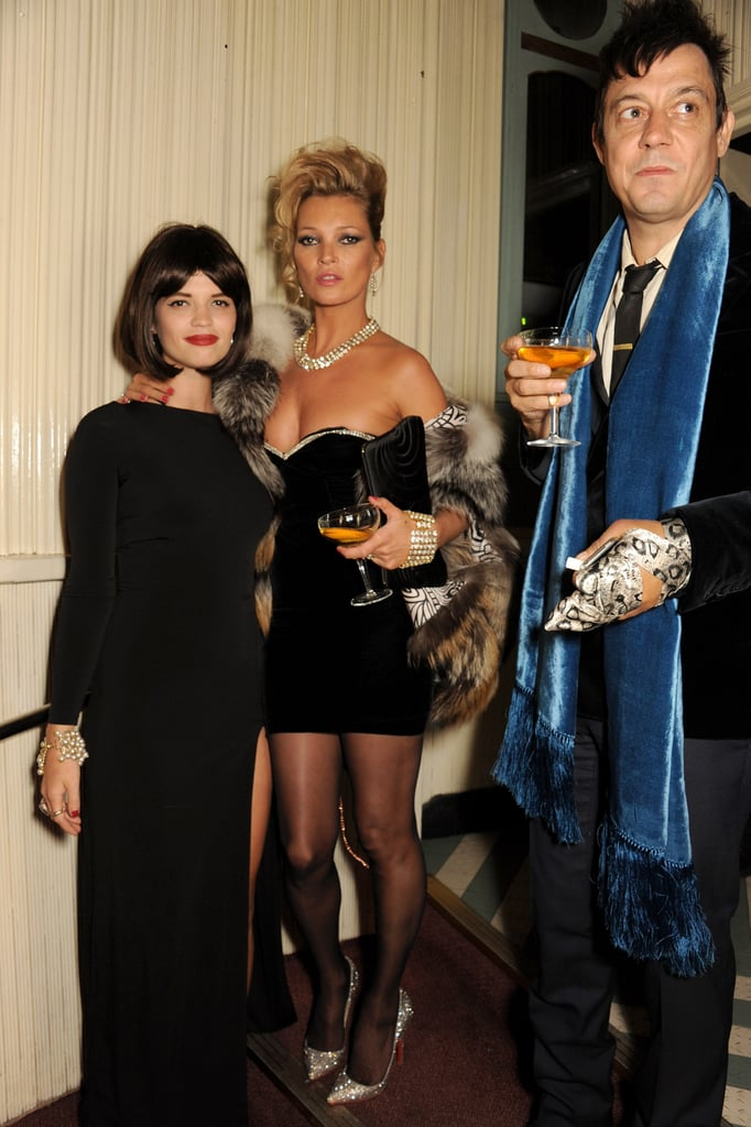 Kate Moss was all about the '80s in a strapless minidress, embellished pumps, and a fur coat at a birthday party in London.