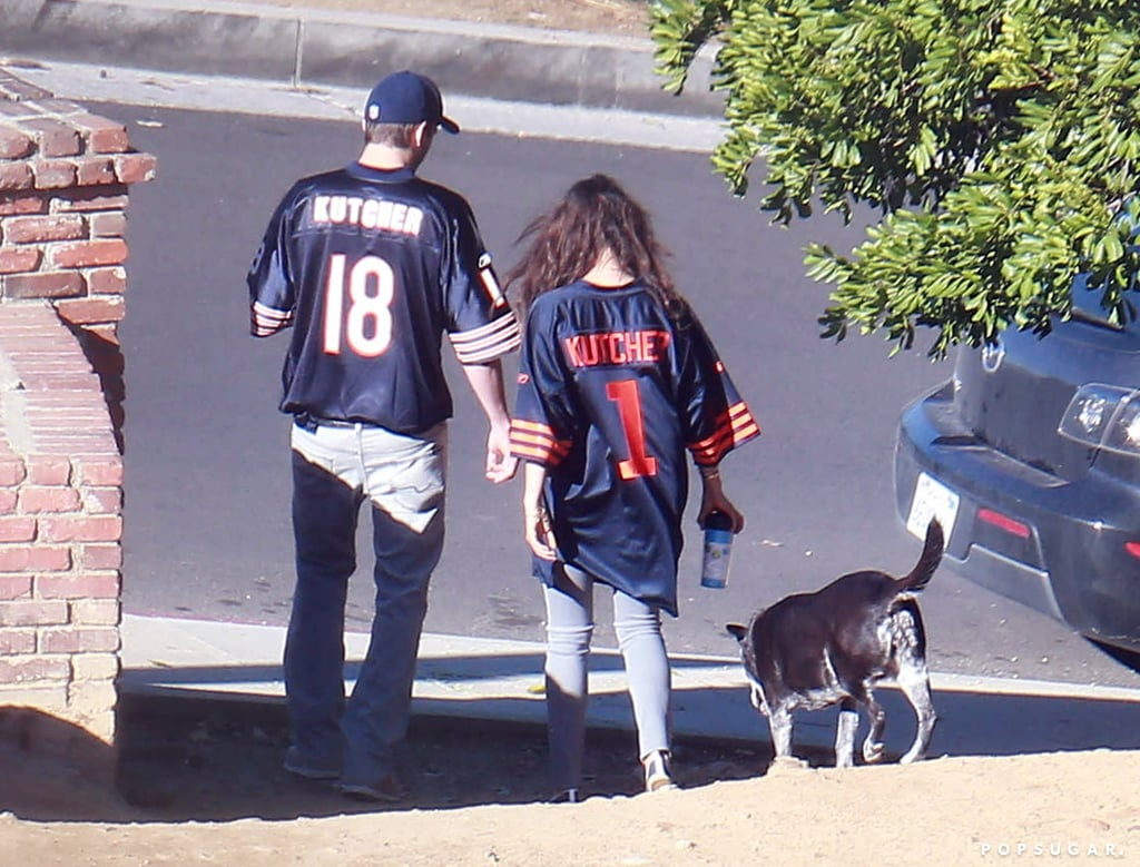 "Mila and Ashton wore matching ""Kutcher"" jerseys out in LA in December 2013."