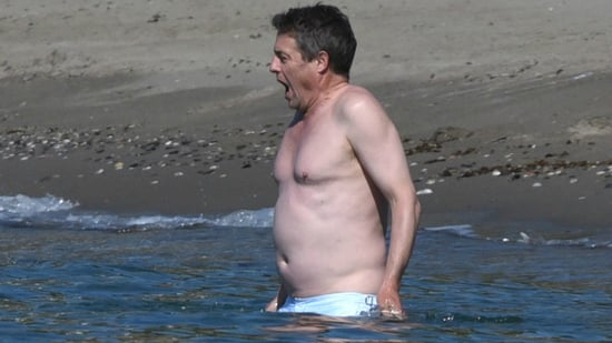 Hugh Grant Takes Shirtless Swim in Absolutely Frigid Waters, Looks Unspeakably Cold