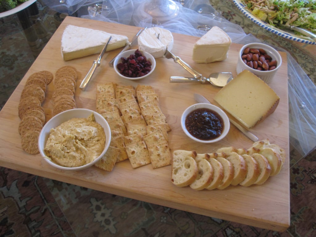 A cheese plate is easy to assemble. The hostesses offered four cheeses, one hard, one brie, one super creamy, and everyone's favorite, Cowgirl Creamery's Mount Tam. The cheese was set on a large board with two kinds of crackers, sliced bread, dried cranberries, fig jam, and toasted almonds.