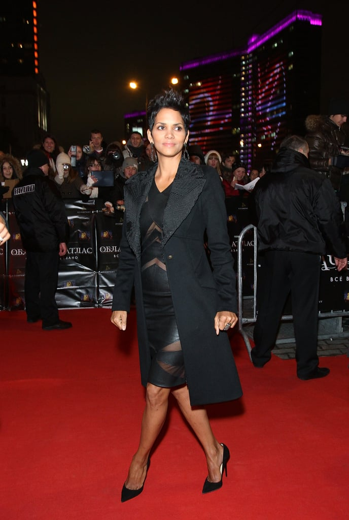 Halle Berry kept warm with a coat.