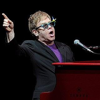 Elton John Reads to His Son