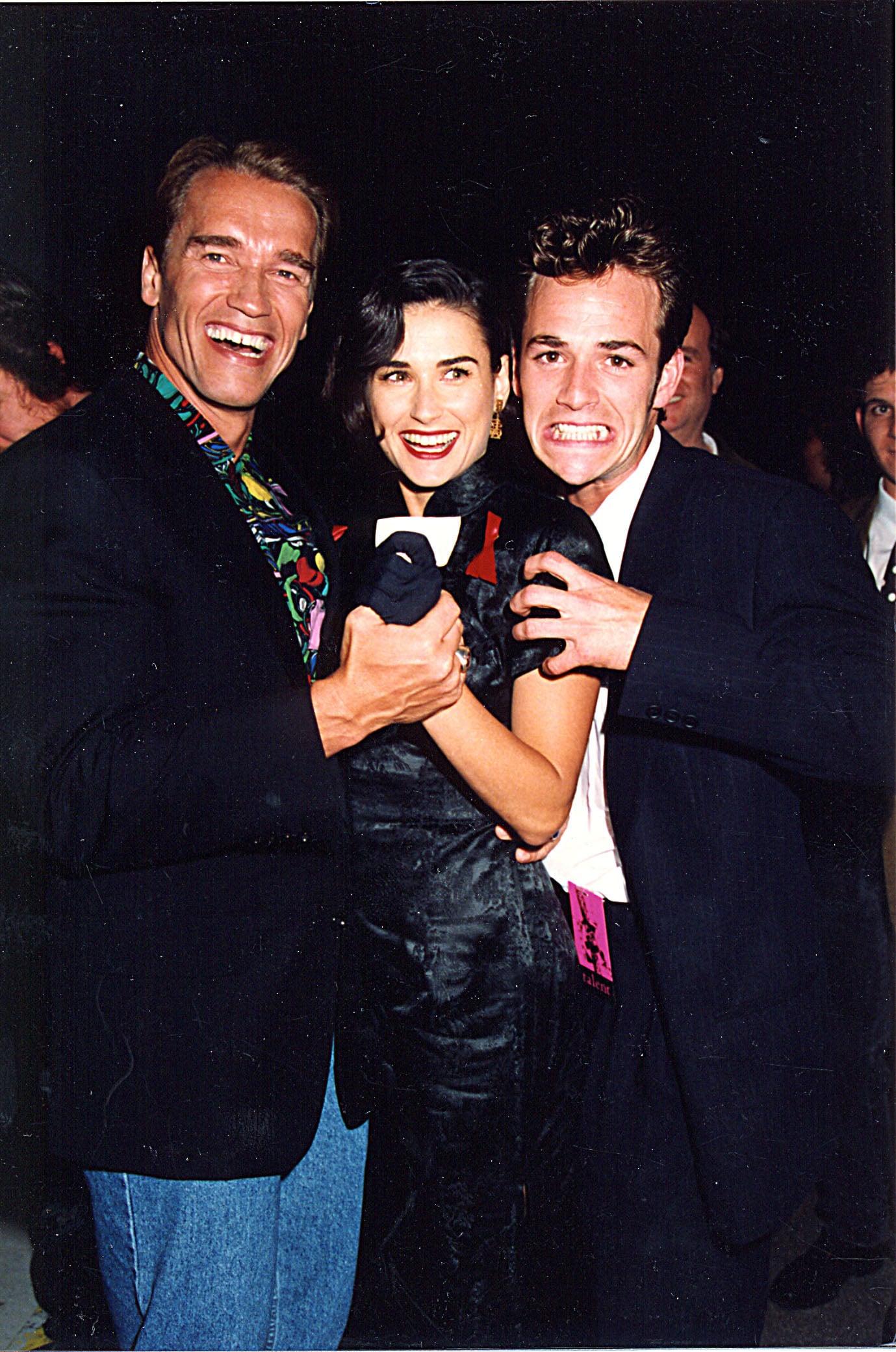 Luke Perry and Arnold Schwarzenegger were part of a Demi Moore sandwich.