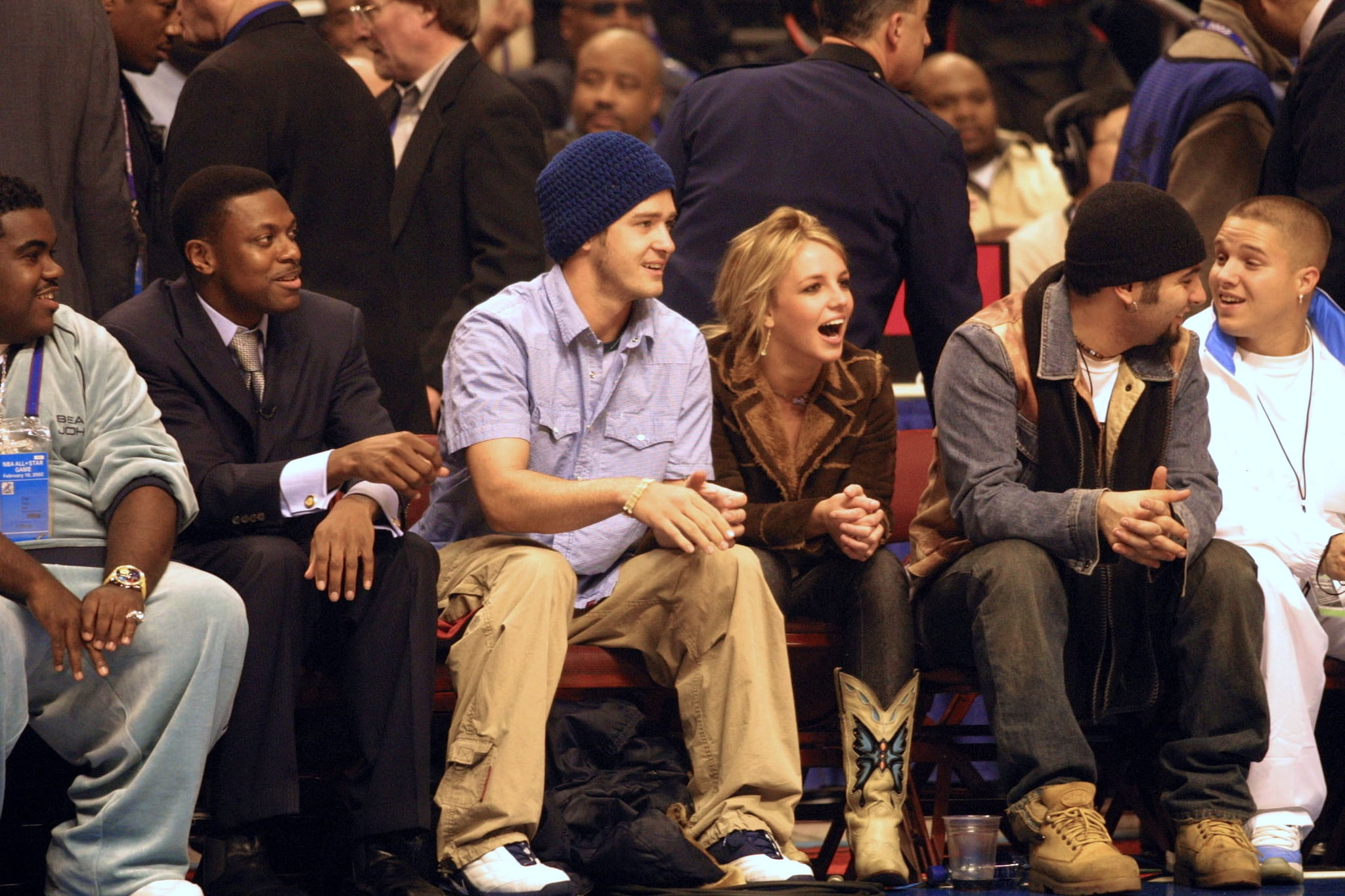 Justin Timberlake sat courtside with Chris Tucker, Chris Kirkpatrick, and then-girlfriend Britney Spears at the NBA All-Star Game in February 2002.