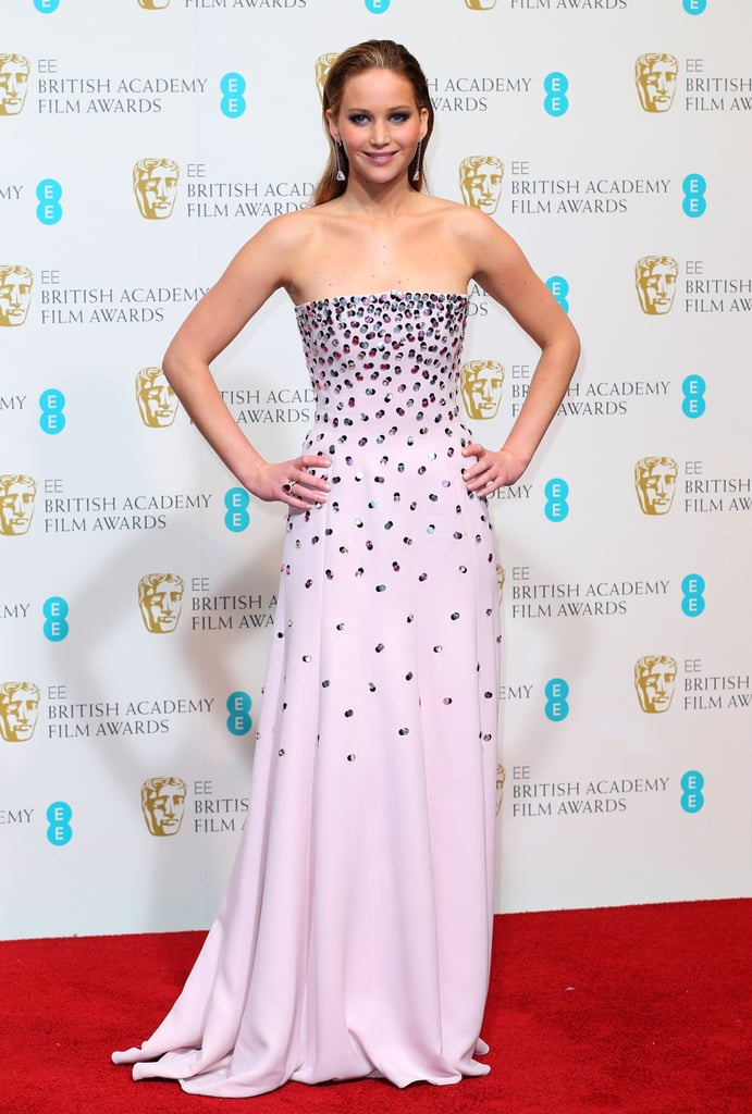 At the 2013 BAFTA Awards in London, Jennifer Lawrence had a pastel moment in her strapless pastel pink gown complete with beaded embellishments and a waterfall train by Christian Dior Haute Couture.