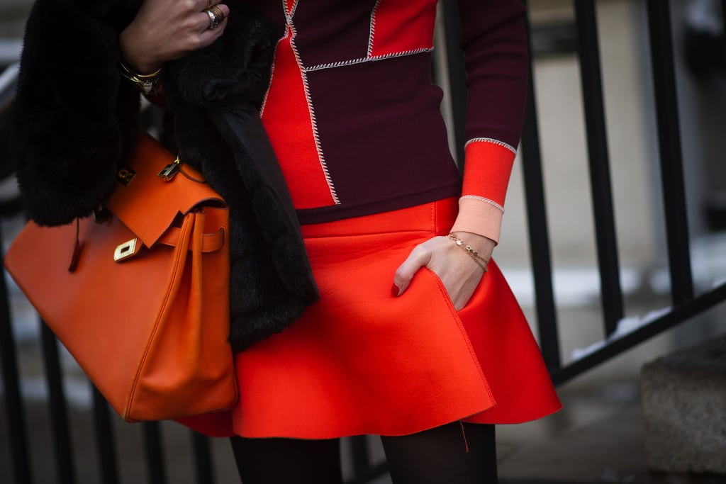 Chiara Ferragni toted a bag to match the bright shades of her outfit.
