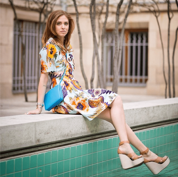 A printed sundress and neutral wedges is a no-fail option for a pretty outdoor ceremony.  Source: Instagram user chiaraferragni