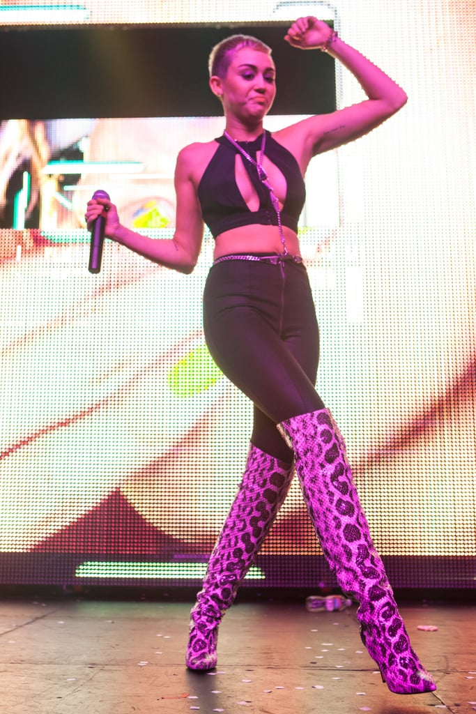 Miley Cyrus wore a revealing outfit to team up with DJ Borgore on stage in LA.