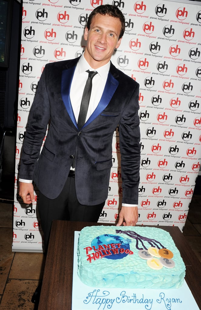 Ryan Lochte smiled with his birthday cake.