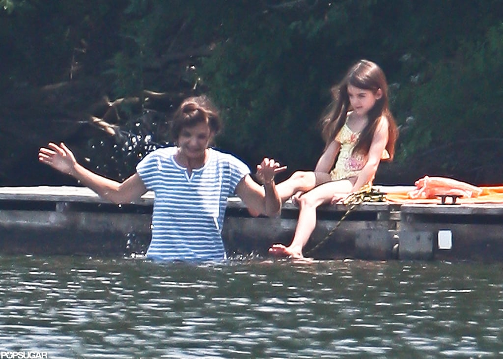 Katie Holmes helped Suri Cruise into a pond while taking a dip in Kent, CT.
