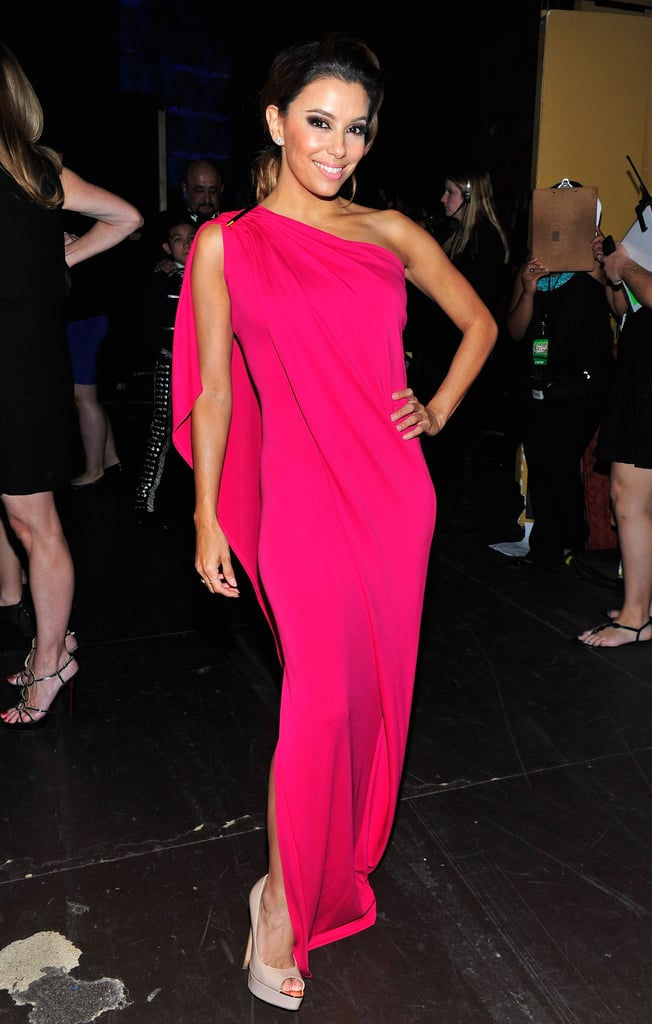 Eva Longoria slipped into a hot-pink dress during the show.