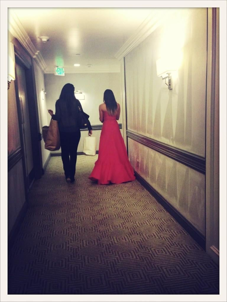 Lea Michele was captured walking down the hotel hallway with her stylist Estee Stanley. Source: Twitter user msleamichele