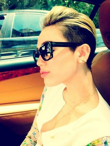 Miley Cyrus showed off her sleek Céline sunglasses while riding in the car. Source: Twitter user MileyCyrus