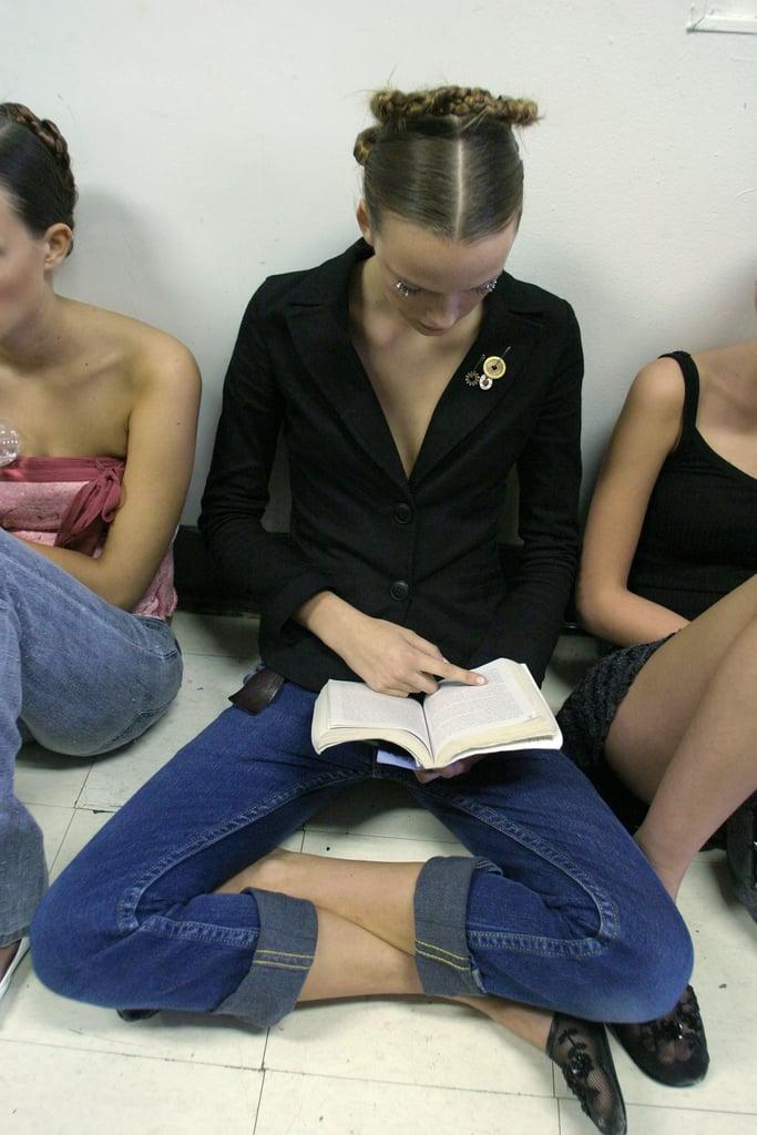 At Benjamin Cho's Spring 2005 show, a model read cross-legged.