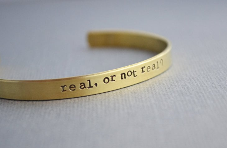 The Hunger Games Real or Not Real Cuff Bracelet ($18)