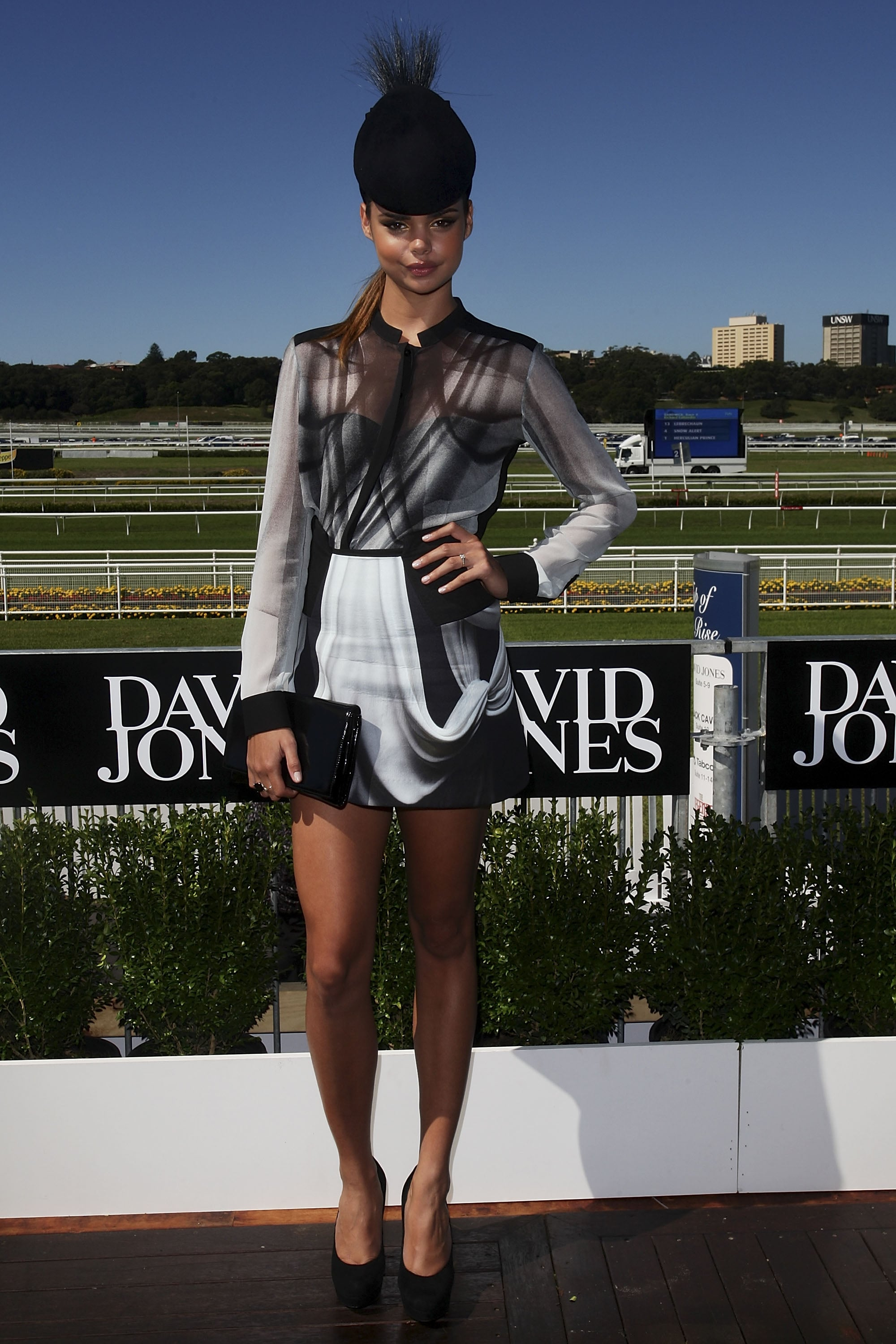 Samantha Harris looked put a modern spin on the monochrome dress code in Dion Lee, accessorized with a Nerrida Winter hat.
