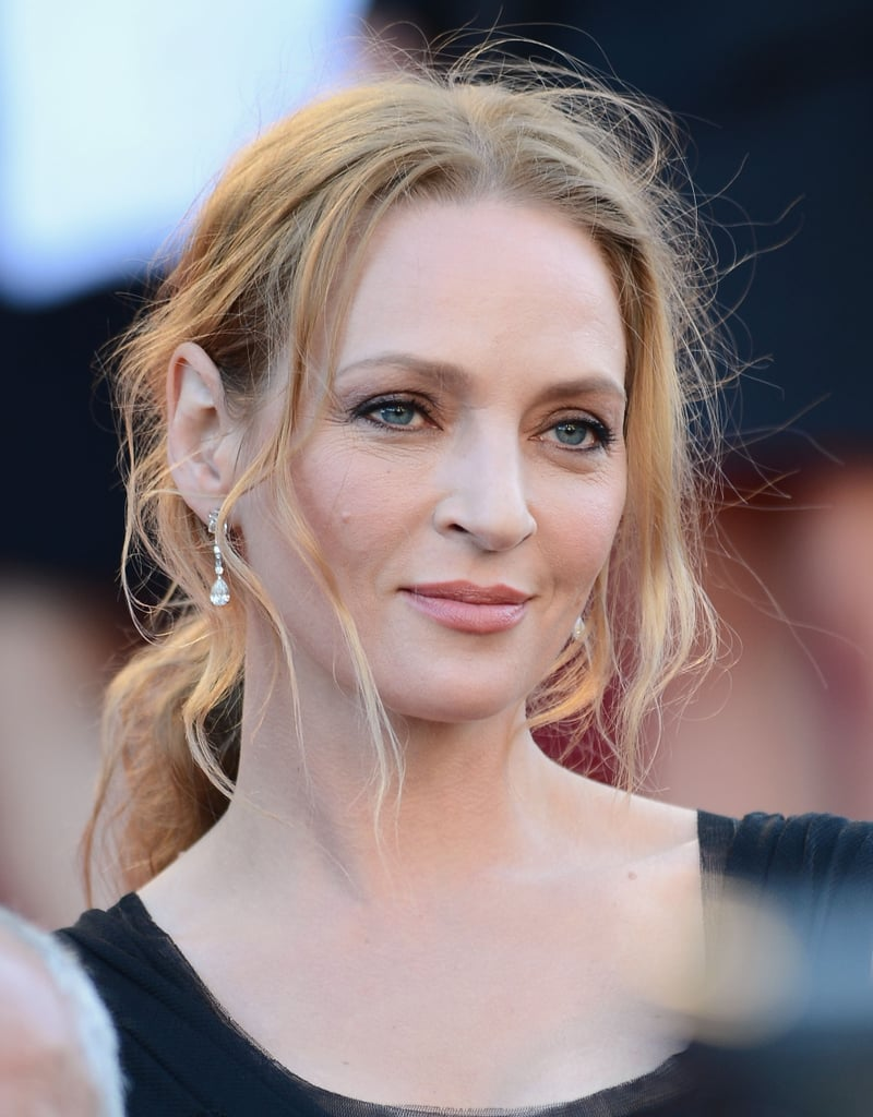 Uma Thurman went for a natural makeup palette and mussed ponytail for the Immigrant red carpet.