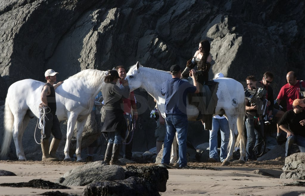 Kristen hopped up on her white horse for a scene.