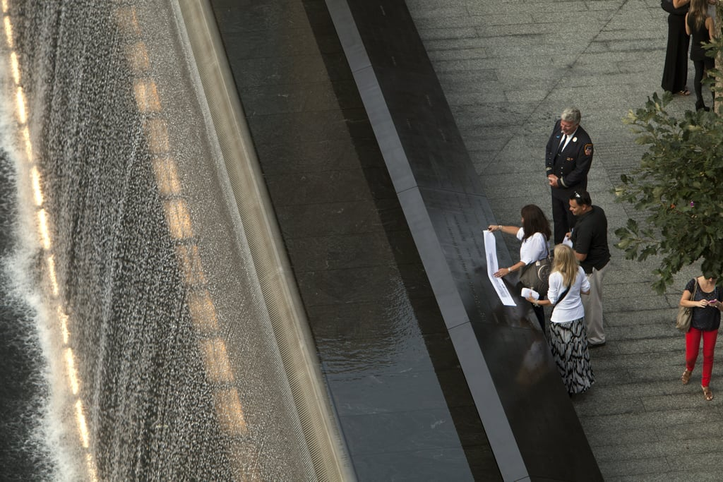 Friends and family of 9/11 victims stopped to make rubbings of names at the NYC memorial site.