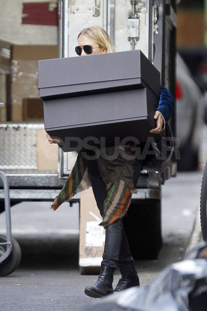Mary-Kate Olsen headed out in NYC with two huge boxes.