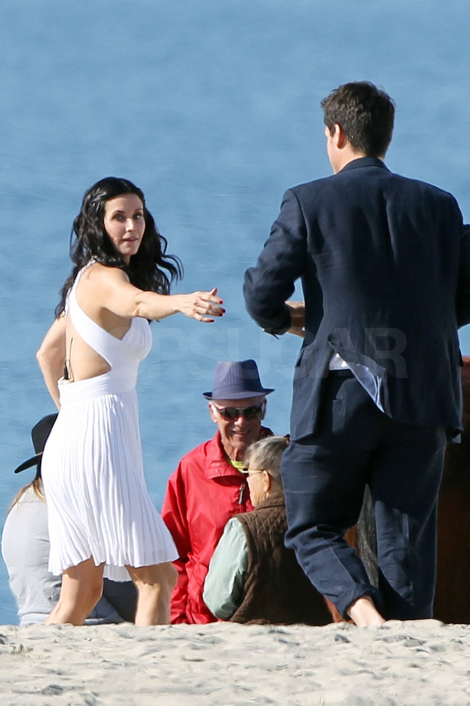 Courteney held out her hand for Josh.