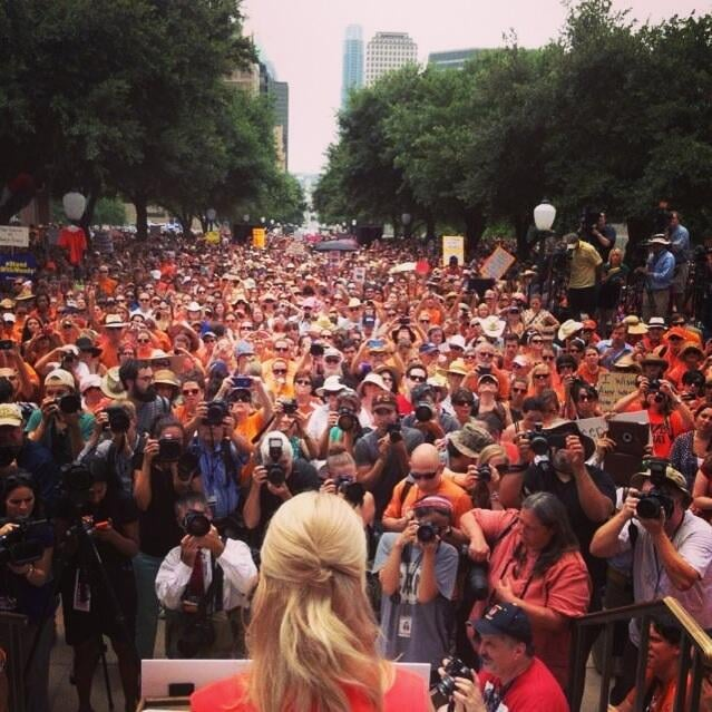 Photographers snapped pictures while Wendy Davis addressed the crowd. Source: Twitter user CecileRichards