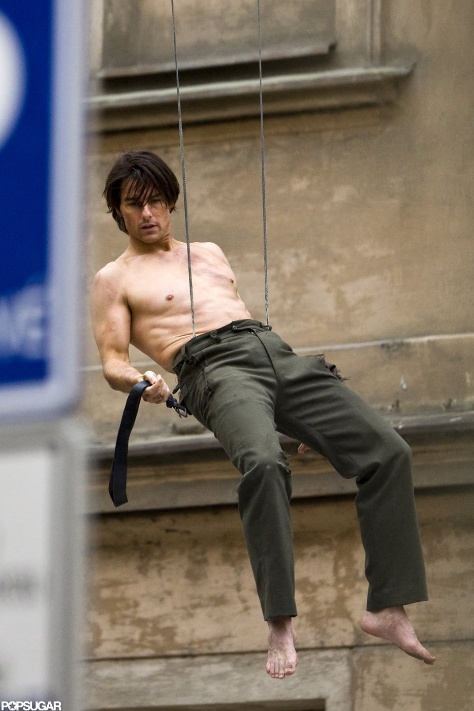 Tom Cruise was shirtless, dangling from a building for the ...