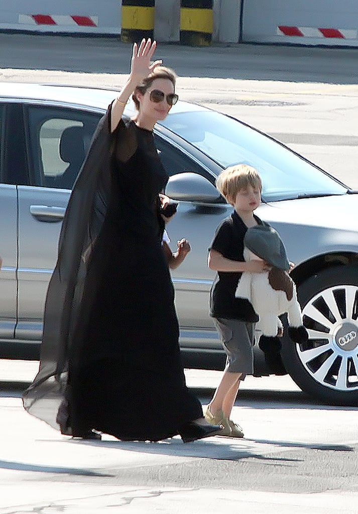 Angelina Jolie waved as she arrived in Sarajevo with Shiloh, Pax, and Zahara Jolie-Pitt in July.
