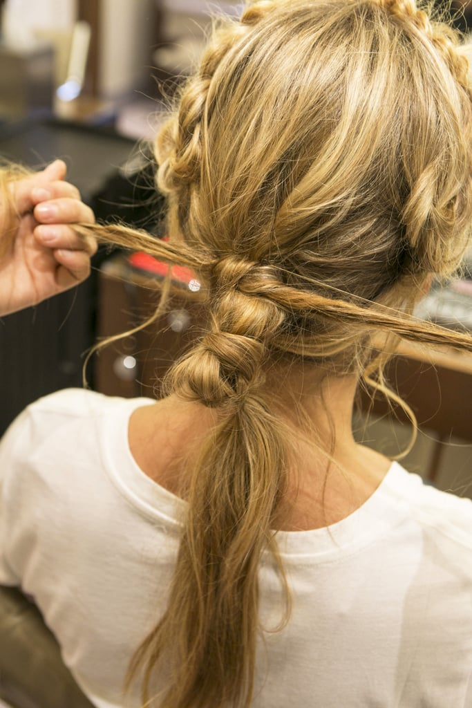 Tie the two ends into a knot around the top of the ponytail base.