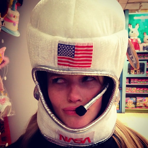 Anne V. tried on a toy astronaut helmet. Source: Instagram user annev_official