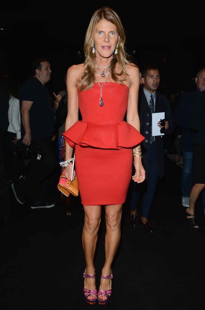 Anna Dello Russo dressed to kill — or rather, impress — in a red peplum number at the Gucci Spring '13 show.