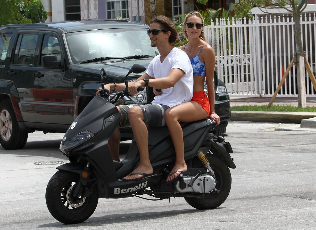 Candice Swanepoel rode around Miami with her boyfriend wearing red, white, and blue.