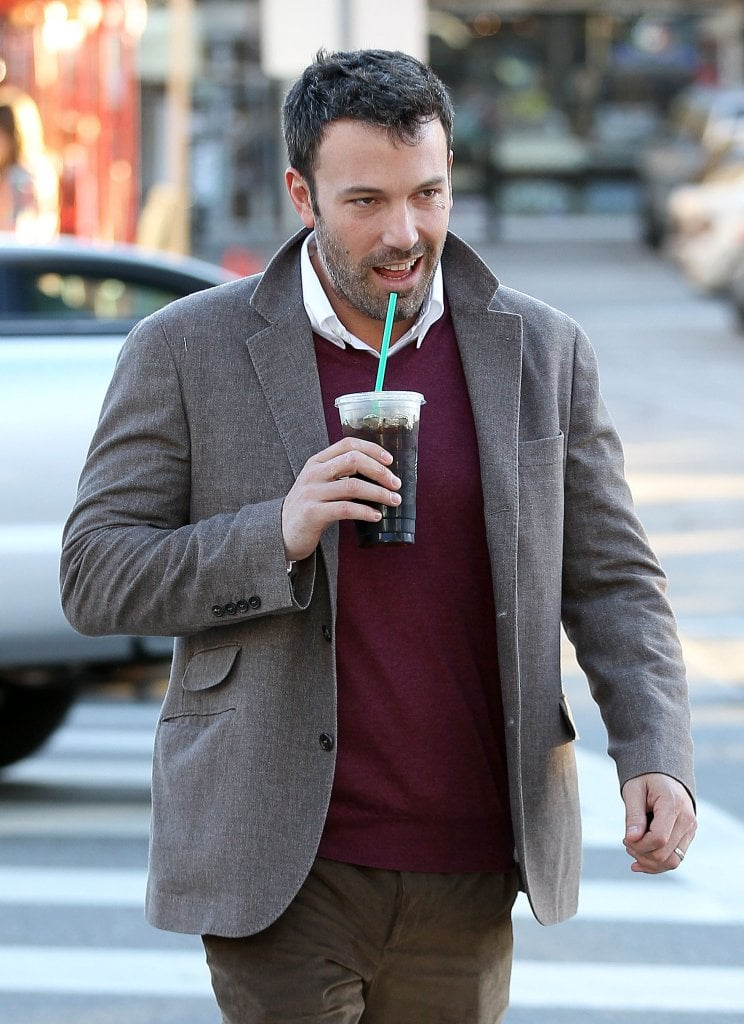 Ben Affleck crossed the street while sipping his drink.