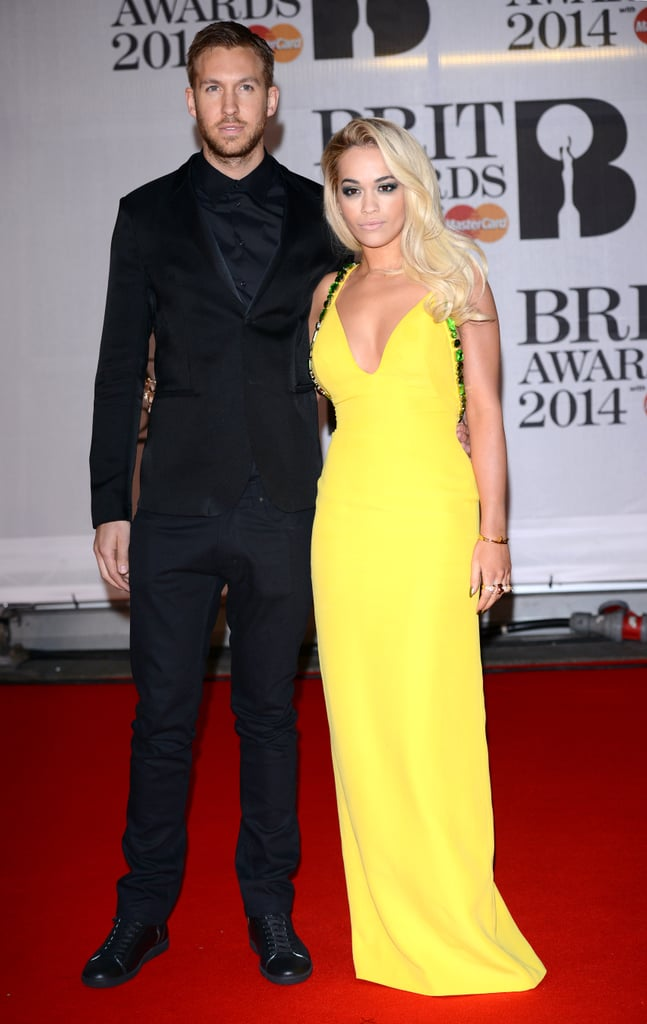 Rita Ora and Calvin Harris stuck close to one another at the Brit Awards in London.